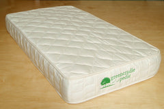 Spring natural crib mattress made with wool for fire retardancy.