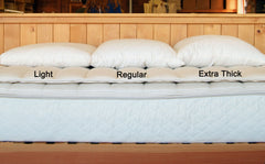 Our clearance wool bed pillow is shown in three different thicknesses.