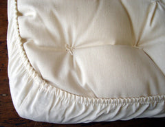 100% certified organic cotton with cotton elastic at the corners for a snug fit over the bassinet mattress