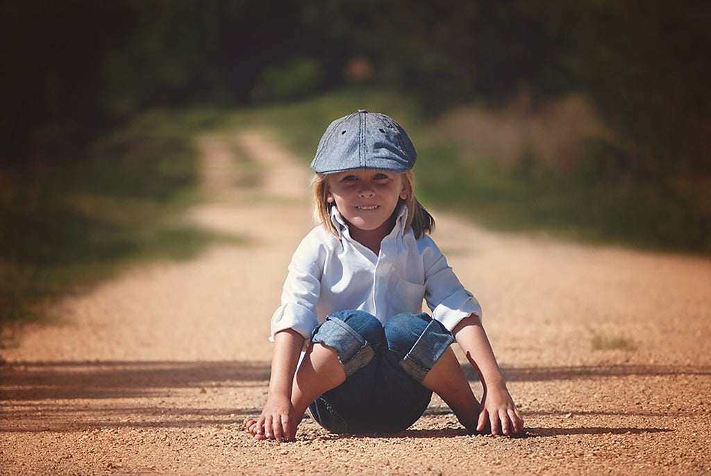 Child sitting on dirt