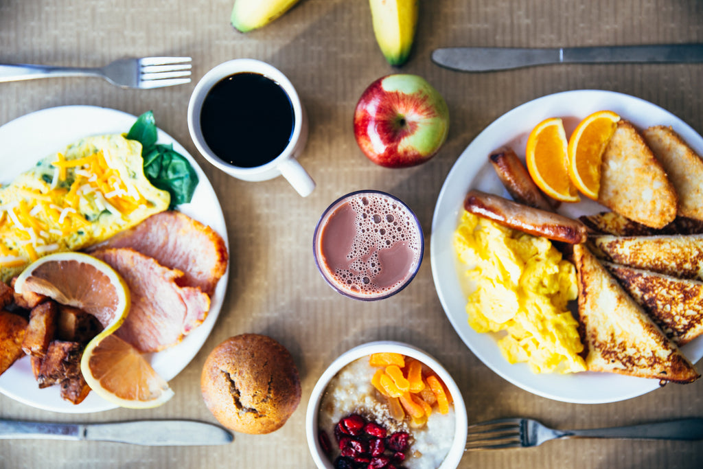 Breakfast with eggs, sausage, toast, and more