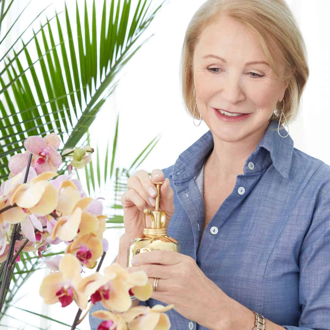Jane Iredale watering orchids