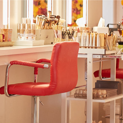 a red chair and jane iredale makeup station