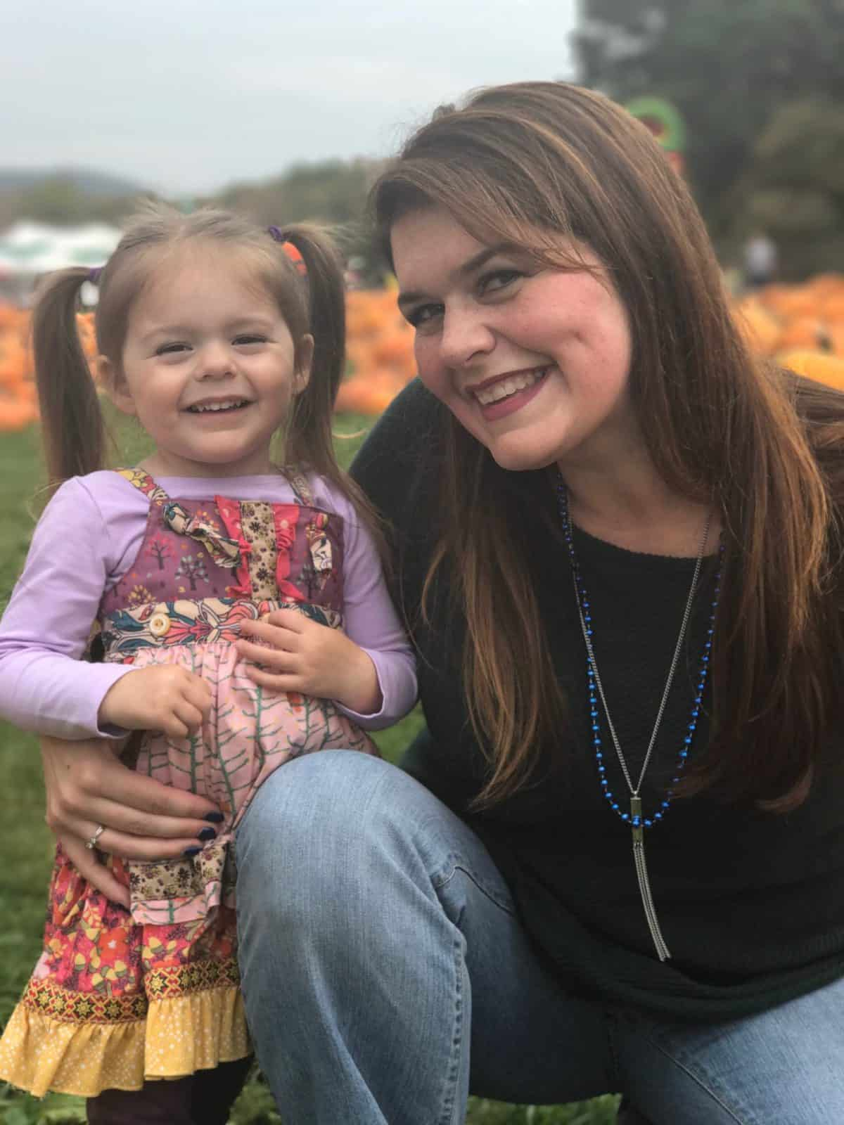 Amy Kuhn and daughter in pumpkin patch