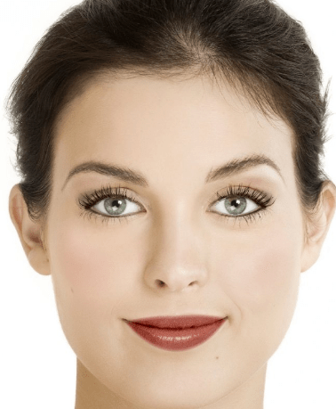 Woman with brown hair with elegant holiday makeup look