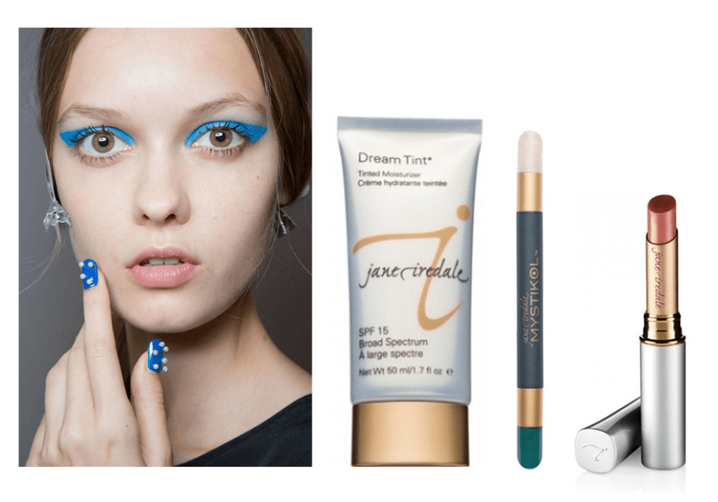 woman with bright blue eyeliner on next to some makeup products