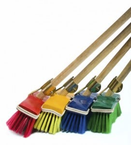 colorful brooms sweeping