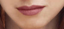 woman's lips with mauve lipstick