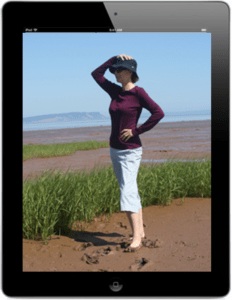 ipad with woman surveying the view on the screen