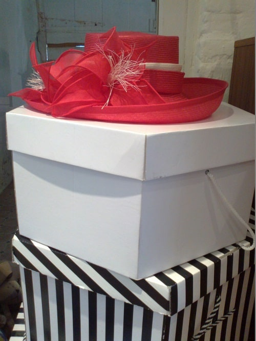 red hat on top of boxes