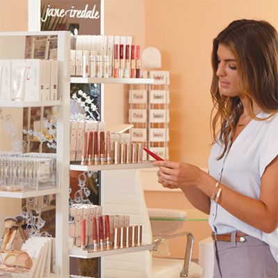 A person looking at jane iredale product fawnly