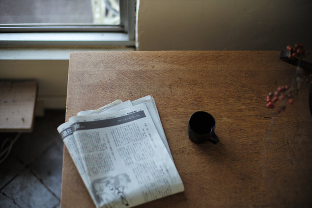 Newspaper on The Table