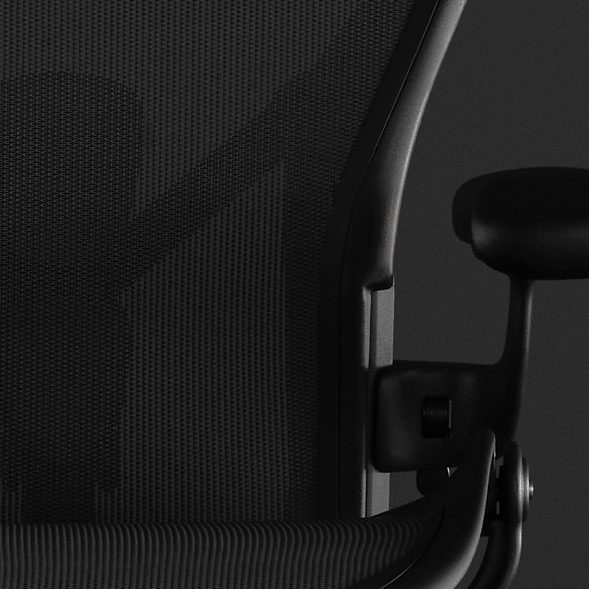 Embody Gaming Chair close-up on Sync Fabric in black with a black background