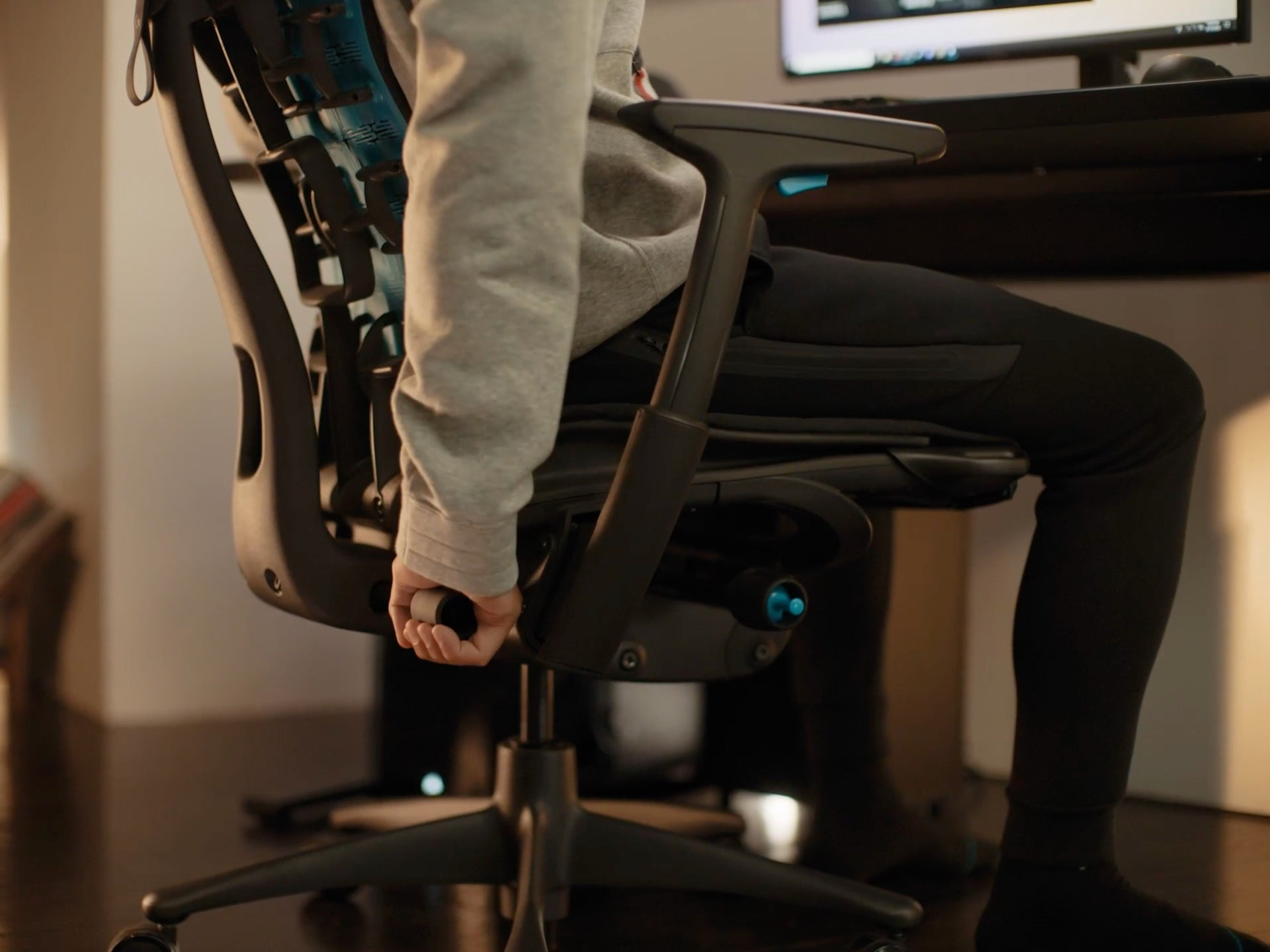 A close-up video of a person's hand adjusting the BackFit on a black Embody Gaming Chair.
