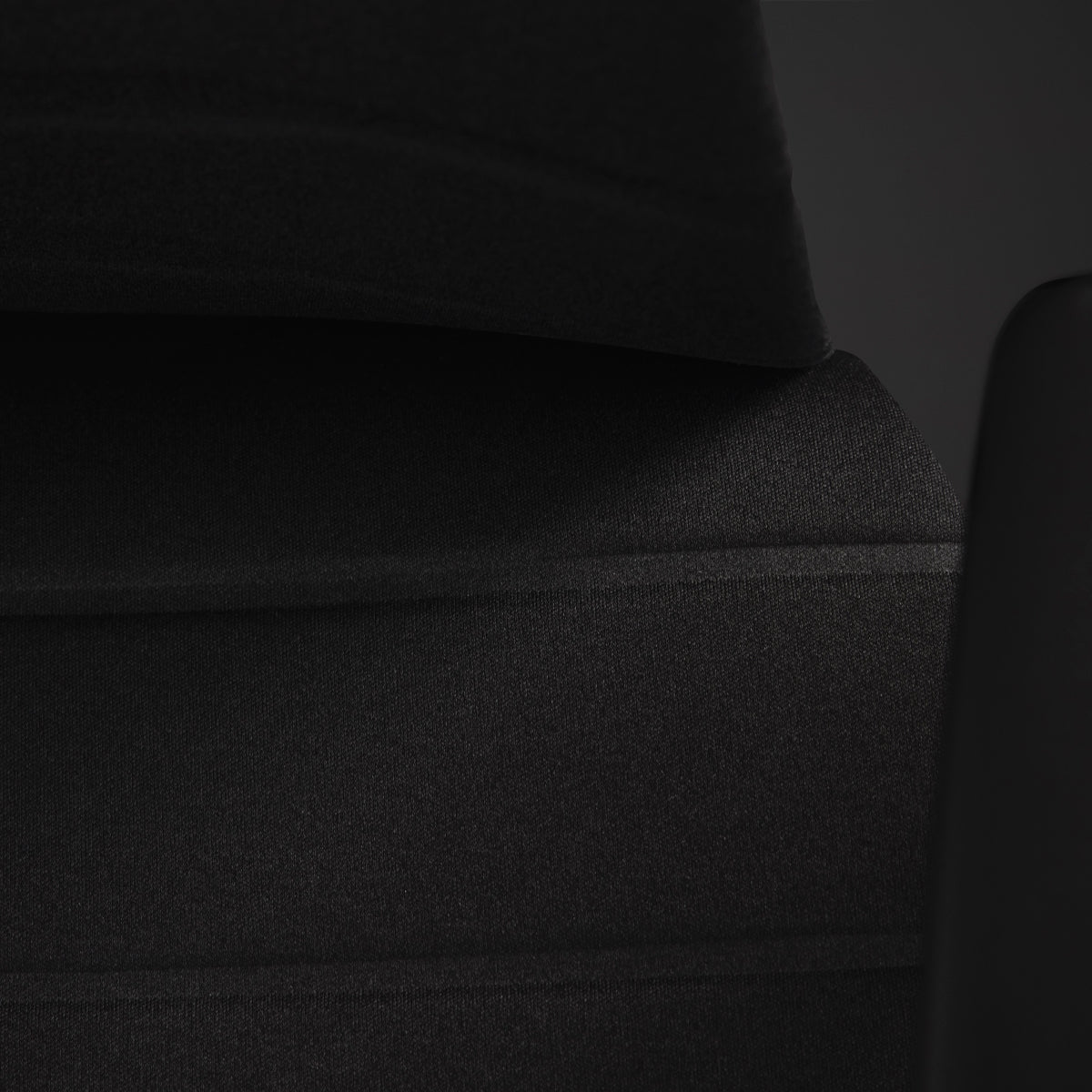 An Embody Gaming Chair close-up on the seat's layered technology with a black background.