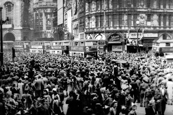 Crowds gathering in celebration at Piccadilly Circus, London