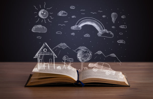 Open book with chalk drawings depicting content