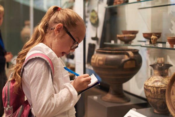 Student looking at Artifacts in a Museum