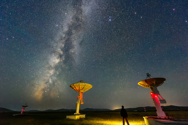 Astrophysicists use high-tech equipment to study the universe.