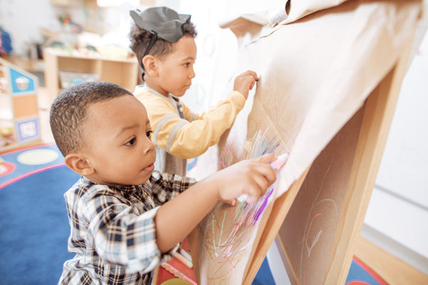 Children concentrating on their artwork