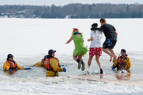 People braving the 'Polar Bear Dip' in Barrie, Canada
