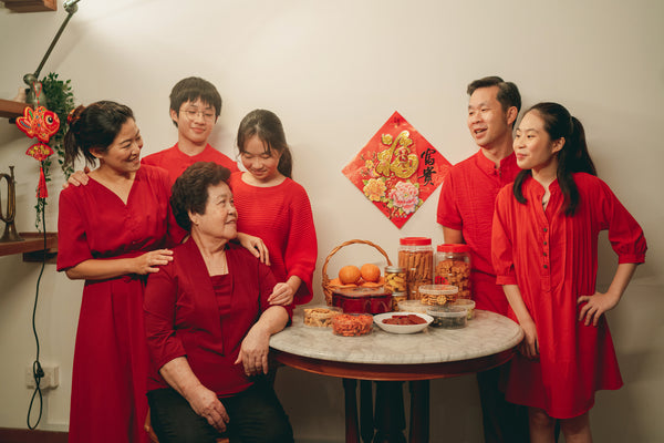 An Asian family dressed in red at Chinese New Year.