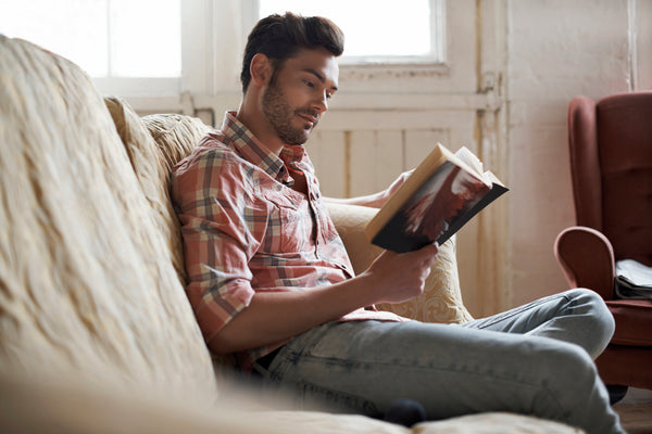 Man reading at home