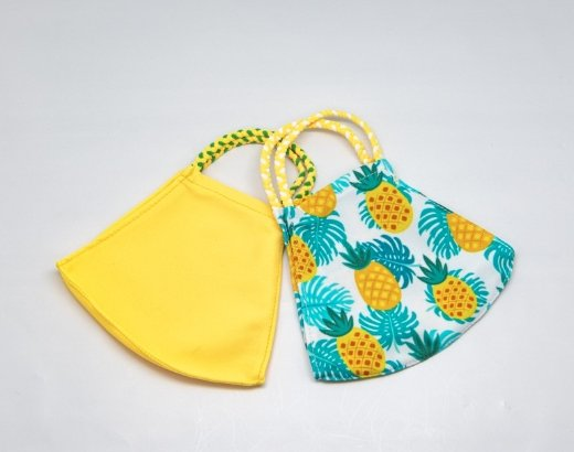 2 Masks:  One with pineapples and one solid yellow - Molly's! A Chic and Unique Boutique