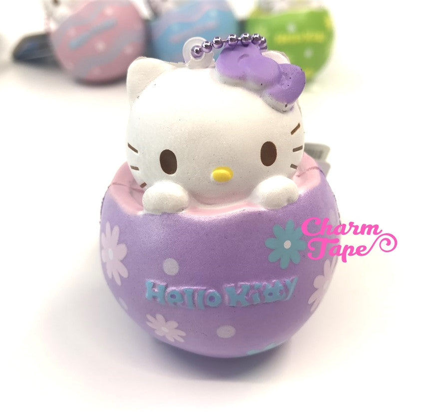 Hello Kitty Chocolate Egg Squishy cellphone charm by Sanrio - Purple flower