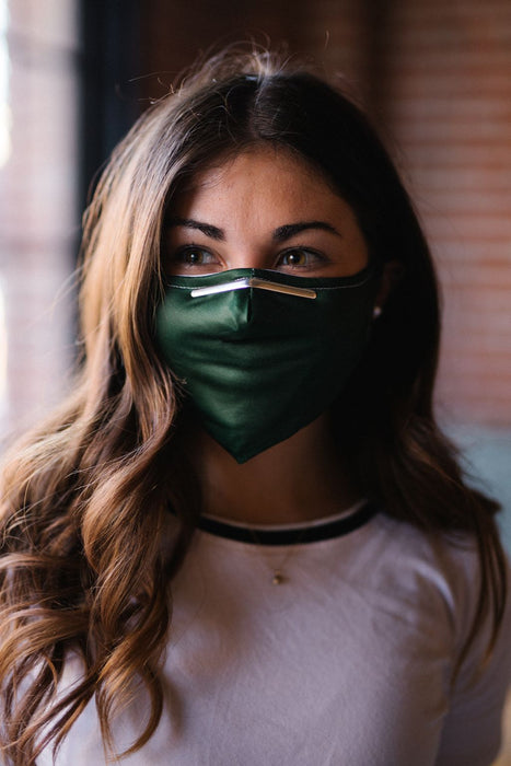 green face mask on model