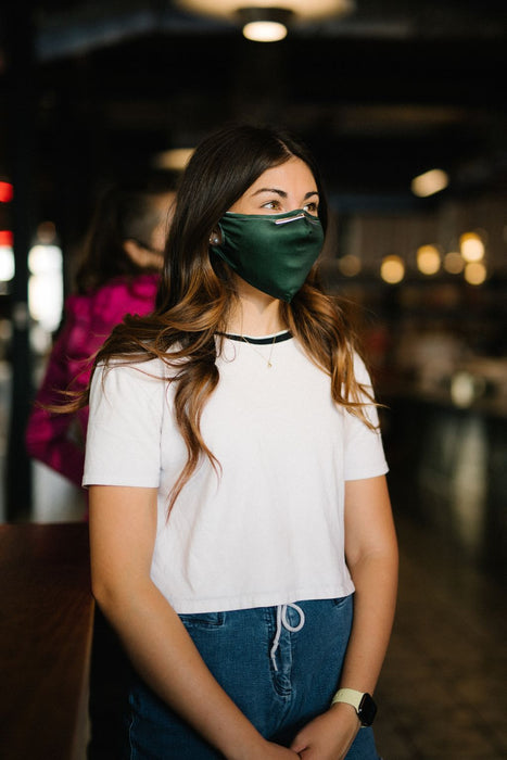 green face mask with nosepiece on model