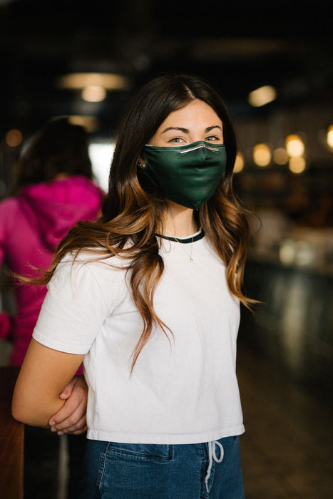 green face mask on model smiling
