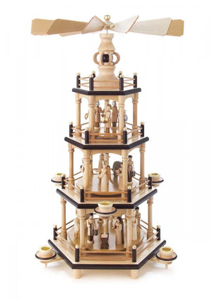 This hand carved Christmas Pyramid Carousel has a Nativity scene, angels, villagers, animals and Roman soldiers