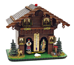 A Black Forest couple are the inhabitants of this weather house in the style of a log cabin. When the sun is shining you can see the woman, when it rains the man comes out of the house. Between the two passages there is a thermometer.