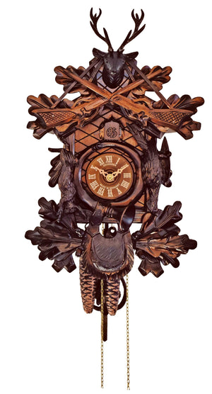 Schneider Hunting Cuckoo clock with a Stag, two Rifles, a rabbit, a pheasant, and a hunting bag