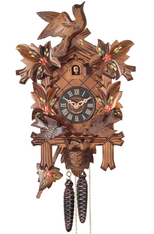 Leaves with painted Roses frame a Traditional Engstler Cuckoo Clock with carved Birds on Top and in a Nest