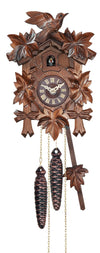 Five Ivy Leaves frame a Traditional Engstler Black Forest Cuckoo Clock with an ornate carved Bird on Top