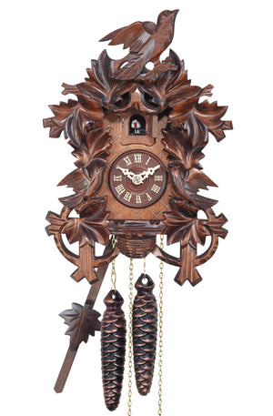 Leaves frame a Traditional Engstler Cuckoo Clock with carved Birds on Top and in a Nest on the bottom