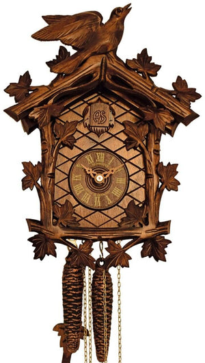Ivy Vines with a carved Cuckoo Bird poised as if about to take flight on a Schneider Cuckoo Clock
