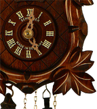 Close up of a  detailed Grape Leaf next to the Dial on a Schneider Traditional Black Forest Cuckoo Clock