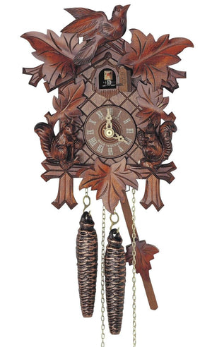 Two Squirrels right and left of the Clock Face and a bird on top of a Schneider Cuckoo Clock