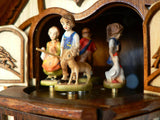 Boy with a Stick and a Deer dancing with three other Children on a Schneider Chalet Cuckoo Clock