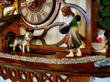 Girl Playing Ball with a German Shepherd while Cat is watching on a Schneider Chalet Cuckoo Clock