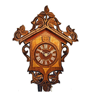 A Schneider Cuckoo Clock with a simple design of leaves and vines in differing colors of stain