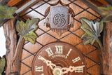 Cuckoo Door with AS the initials for Anton Schneider framed by Green Leaves Traditional Cuckoo Clock