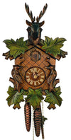 A Schneider Cuckoo Clock with Two Birds and green Leaves next to the clock face and a Stag on Top