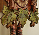 Three Green Leaves, Weights and the  Clock Face with Made in Germany on a Schneider Cuckoo Clock