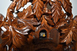 Cuckoo Bird peeking out of the dense woods associated with the Black Forest on Schneider Cuckoo Clock.