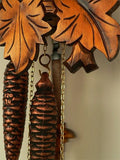 Yellow Leaves, two Weights and the Pendulum of an Anton Schneider Traditional Black Forest Cuckoo Clock