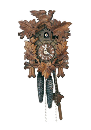 Traditional Schneider Cuckoo Clock with a carved Bird on Top of the clock and vine leaves on the sides